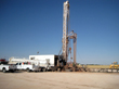 West Texas Water Well Services' drill rig and ancillary vehicles
