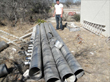 Irrigation metal pipes that were cut in half (lengthwise) and used as gutters to channel rainwater to downspouts.