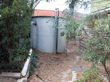 Another view of the tank at the front of the house with the air gap.