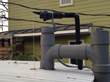 Close-up view of the air gap on the tank at the front of the house.