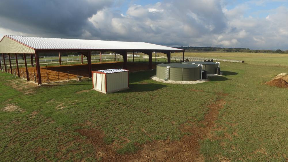 Oblique view of the riding arena and storage tanks.