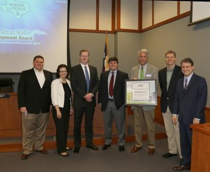 Receiving the award at the board meeting.